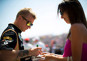 Hungarian Grand Prix 2013<br /> our best selection from Award winning Photographer Darren Heath.<br /> Raikkonen sign autographs before the race<br /> ©Darren Heath/Exclusivepix
