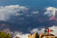 """Tourists making """"selfies"""" of themselves from Desert View of the gathering storm over the Canyon"""