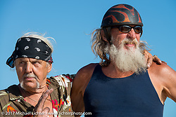 Antique enthusiast Steve Coe (r) with a friend at the AMCA Sunshine Chapter Swap Meet during Daytona Beach Bike Week. FL. USA. Saturday March 11, 2017. Photography ©2017 Michael Lichter.