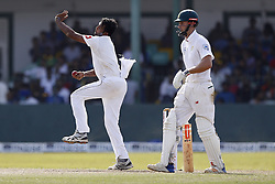 July 22, 2018 - Colombo, Sri Lanka - Sri Lankan cricketer Dilruwan Perera (L) delivers a ball as South African cricketer Theunis de Bruyn looks on during the 3rd day's play in the 2nd test cricket match between Sri Lanka and South Africa at SSC International Cricket ground, Colombo, Sri Lanka on Sunday  22 July 2018  (Credit Image: © Tharaka Basnayaka/NurPhoto via ZUMA Press)