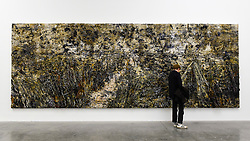 """© Licensed to London News Pictures. 14/11/2019. LONDON, UK. A visitor views """"Untitled"""", 2018-2019, by Anselm Kiefer at the preview of a new exhibition called """"Superstrings, Runes, The Norns, Gordian Knot"""" by Anselm Kiefer.  The works include large scale paintings and installations that draw on the scientific concept of string theory and are on display at the White Cube Gallery in Bermondsey 15 November to 26 January 2020.  Photo credit: Stephen Chung/LNP"""