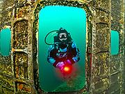 Scuba diver checks inside the Aircraft Challenger 600 at Dutch Springs, Scuba Diving Resort in Pennsylvania