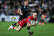 Gareth Davies of the Scarlets scores a try. Guinness Pro14 rugby match, Ospreys v Scarlets at the Liberty Stadium in Swansea, South Wales on Saturday 7th October 2017.<br /> pic by Andrew Orchard, Andrew Orchard sports photography.