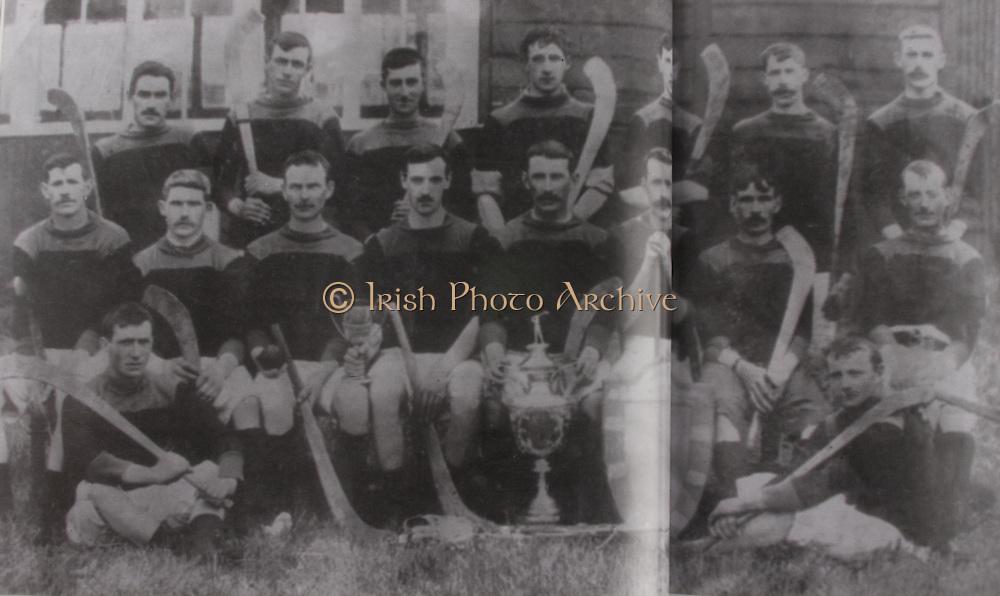 """Kilkenny (Tullaroan)- All-Ireland Hurling Champions 1904. Back Row: Dick Brennan, """"Drug"""" Walsh, Eddie Doyle, Paddy """"Icy"""" Lanigan, John James Brennan, Martin Lalor, Jack Hoyne. Front Row: Jim Dunne, SIm Walton, Pat Fielding, Dan Stapleton, Ger Doheny (capt), Jim Lalor, Jack Rochfort, Pat """"Fox"""" Maher. Foreground: Dick Doyle, Paddy Saunders, J J Brennan and Jim Dunne stood in for Fr Dan Grace and Jack Anthony who had played in final but were not available when the photo was taken."""