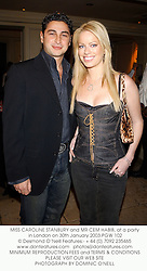 MISS CAROLINE STANBURY and MR CEM HABIB, at a party in London on 30th January 2003.PGW 102