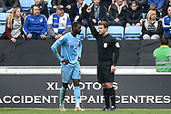 Coventry City forward (on loan from Wolverhampton Wanderers)Bright Enobakhare (24) shown a yellow card, booked during the EFL Sky Bet League 1 match between Coventry City and Bristol Rovers at the Ricoh Arena, Coventry, England on 7 April 2019.