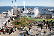 View on the rooftop terrasse over the sea as far as to Sweden. Wind Turbines dot the waters.