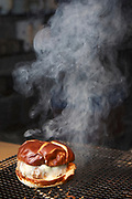 NEW YORK, NY - November  8, 2017:  A hamburger prepared by Chef Masa Takayama in the basement grill at Tetsu, the chef's new casual restaurant in TriBeCa.<br /> <br /> CREDIT: Clay Williams for The New York Times.<br /> <br /> © Clay Williams / claywilliamsphoto.com
