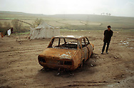 Villagers return to Ugrak, eastern Turkey, even after three were shot and their car burned by local village guards who wanted to keep their lands.