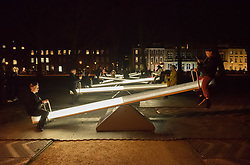 """© Licensed to London News Pictures. 27/02/2020. Bristol, UK. Bristol Light Festival; the artwork """"Wave-field Variation Q"""" at Queen Square, a collection of eight giant illuminated see saws created by Lateral Office and CS Design. This is the launch of the first ever Bristol Light Festival, hosted by Bristol City Centre BID. Internationally renowned artists and local talent lighting up the city with a series of installations this weekend. Photo credit: Simon Chapman/LNP."""
