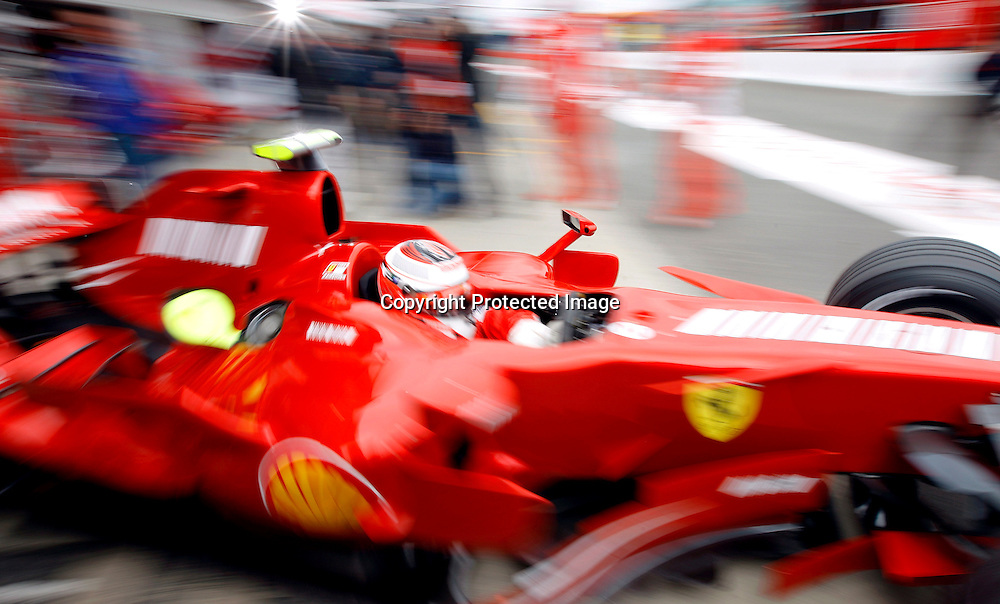 epa01057797 Finnish Formula One driver Kimi Raikkonen of Ferrari steers his car at the pit lane during first practice session at the Silverstone race track in Northamptonshire, Britain, 06 July 2007.  EPA/KERIM OKTEN