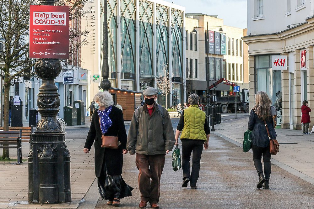 22nd February, Cheltenham, England. Shoppers walk through the town centre during the third national lockdown.