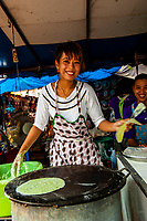 A Thai woman cooking at an open air market, Viharn Phra Mongkol Bopit, Ayutthaya Historical Park, Ayutthaya, near Bangkok, Thailand