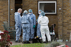 October 3, 2017 - London, London, UK - LONDON, UK.  Police officers and forensics in Hood Road in Rainham. Police were called to an address in Hood Road, Rainham at around 11:30 on Monday 2nd  October, where they found the body of a 51 year old man, who was pronounced dead at the scene. A murder investigation has been launched and a 46 year old man arrested. (Credit Image: © Vickie Flores/London News Pictures via ZUMA Wire)