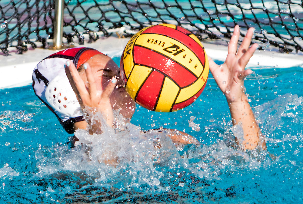 Santa Ana's Victoria Lopez attempts to block a shot during her teams 21-3 loss against Golden West during the Orange Empire Conference tournament.