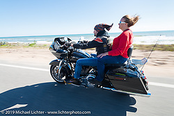 Danilo Dibierro of Italy out for a ride with Melissa Shoemaker on Danilo's rented Harley-Davidson dresser during Daytona Bike Week. FL, USA. March 14, 2014.  Photography ©2014 Michael Lichter.