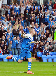 Peterborough United's Marucs Maddison celebrates scoring his goal - Photo mandatory by-line: Joe Dent/JMP - Mobile: 07966 386802 06/09/2014 - SPORT - FOOTBALL - Peterborough - London Road Stadium - Peterborough United v Port Vale - Sky Bet League One