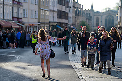 © Licensed to London News Pictures. 01/05/2017. Oxford, UK. A young woman dancing at sunrise in the street as Oxford University students and members of the public celebrate May Day in the early hours of the morning near Magdalen Bridge in Oxford, Oxfordshire. Students were again prevented from jumping from the bridge in tot he water, which has historically been a tradition, due to injuries at a previous years event . Photo credit: Ben Cawthra/LNP