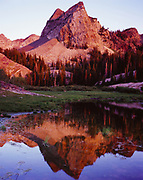 Sunset light illuminating Sundial Peak reflected in Lake Blanche, Big Cottonwood Canyon, Wasatch Range, Twin Peaks Wilderness Area, Wasatch-Cache National Forest, Utah.