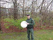 Now THAT'S a deer in a headlight: Conservation cop saves animal after getting its head stuck in a light globe<br /> <br /> A New York State conversation cop saved a deer that was literally caught in a head light.<br /> Environmental Conservation Officer Jeff Hull was called to Centereach on Long Island to reports of a deer that had managed to get its head stuck inside a light globe from a lamppost on Tuesday morning.<br /> The report said the animal had got its head stuck inside the globe and had been laying in the woods since the night before, the New York State Department of Environmental Conservation said on its Facebook page.<br /> <br /> Upon arrival, Officer spotted the deer about 20 yards from the road in a housing development.<br /> Officer Hull approached the deer, but on his first attempt, 'the wet globe slipped out of his hands.'<br /> Unable to see, the deer then ran into a nearby downed tree and fell down, the department said.<br /> <br /> But then, Officer Hull threw his coat over the globe and grabbed it with both arms 'as the deer kicked and struggled to break free.'<br /> At this point, the deer managed to slip its head out of the globe and ran off into the woods.<br /> 'ECO Hull was left with a good story and a few bruises, but his integrity intact,' the department added.<br /> <br /> Photo shows: Environmental Conservation Officer Jeff Hull (pictured) suffered a few bruises during his encounter with the deer in Centereach on Long Island<br /> ©Exclusivepix Media