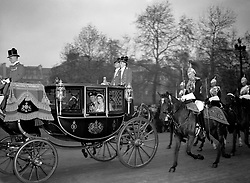 File photo dated 20/11/47 of H.R.H the Duke of Edinburgh waving to the crowd as he rides in a glass coach with his bride, Princess Elizabeth, on their return from Westminster Abbey. Issue date: Friday April 9, 2021. PA Photo See PA story ROYAL Philip Wedding. Photo credit should read: PA/PA Wire