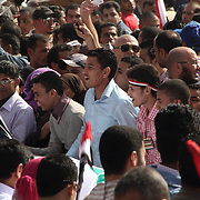 Young men share a joke as they unfurl an enormous Palestinian flag in Cairo's Tahrir Square.