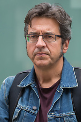 Author, journalist and environmental campaigner George Monbiot waits to address Extinction Rebellion and other activists outside the Department for Business, Energy and Industrial Strategy (BEIS) following the Stop The Harm march on the fourth day of Impossible Rebellion protests on 26th August 2021 in London, United Kingdom. Extinction Rebellion are calling on the UK government to cease all new fossil fuel investment with immediate effect.