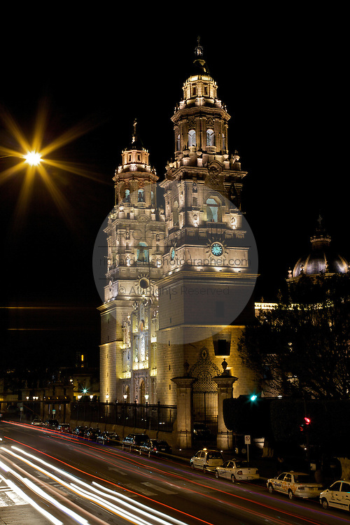 Morelia Cathedral at night on the Plaza de Armas Morelia, Michoacan state Mexico. The city is a UNESCO World Heritage Site and hosts on of the best preserved collection of Spanish Colonial architecture in the world. Commissioned by the Duke of Albuquerque, appointed Viceroy to the territories of Mexico, ordered its construction in 1660 which was carried out by the Italian master Vicente Barroso until his death in 1692 it took an additional 52 years to complete. The Cathedral has the highest and bulkiest church towers of the continent.