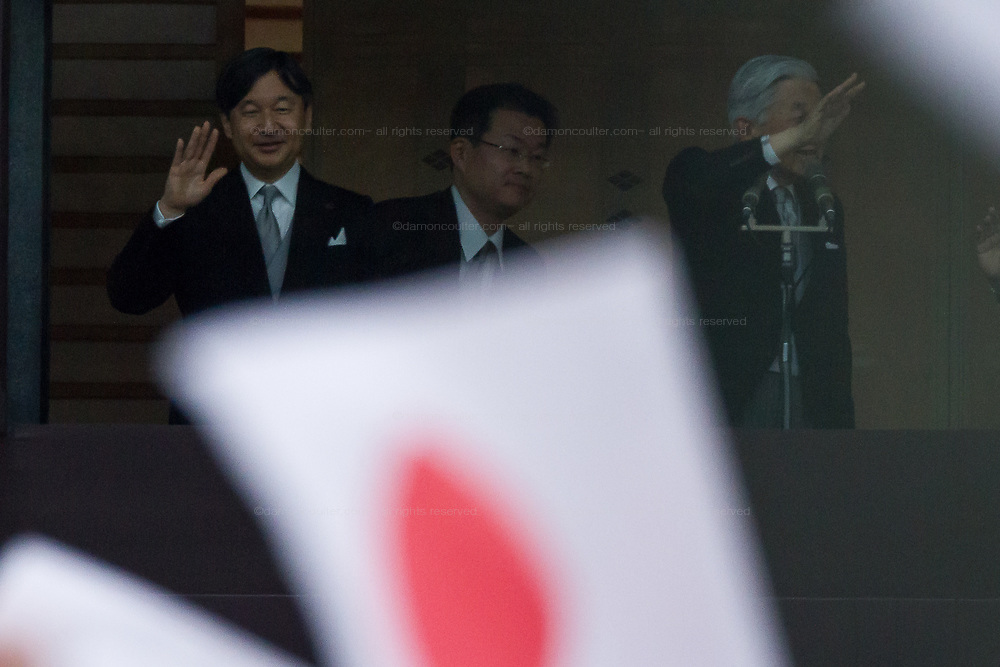 Crown Prince Naruhito, (left) and  Emperor Akihio (right) speak to  well-wishers at the Imperial Palace to celebrate the 85th birthday of Emperor Akihito of Japan. The Emperor, who is the son of Japan's wartime leader, Emperor Hirohito, gave a speech to mark his last birthday before his upcoming abdication, saying he felt relief that his reign was coming to an end without having seen his country at war again and that it was important to continue to educate young people about japan's wartime past. Imperial Palace, Tokyo, Japan. Sunday December 23rd 2018
