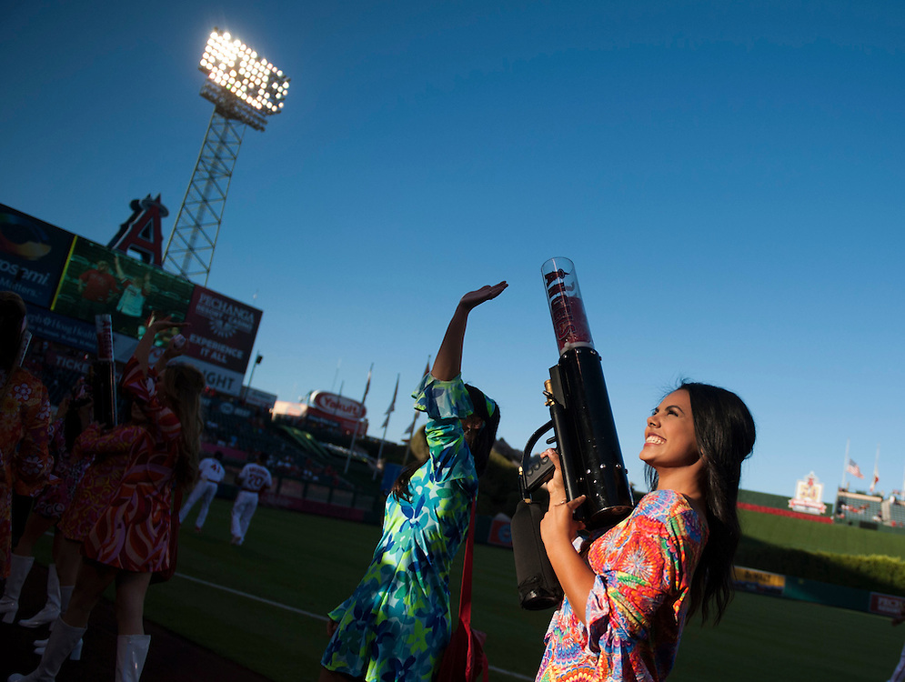 The Strike Force takes the field during 70's Night at Angel Stadium on Friday.<br /> <br /> ///ADDITIONAL INFO:   <br /> <br /> angels.0716.kjs  ---  Photo by KEVIN SULLIVAN / Orange County Register  -- 7/15/16<br /> <br /> The Los Angeles Angels take on the Chicago White Sox at Angel Stadium.