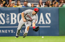 Jun 15, 2018; Pittsburgh, PA, USA; Cincinnati Reds left fielder Adam Duvall (23) field a ball in the outfield during the eighth inning against the Pittsburgh Pirates at PNC Park. Mandatory Credit: Ben Queen-USA TODAY Sports