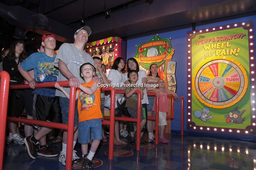 Tourists watch a Simpson's pre-ride video in the queue for the newly-opened The Simpson's Ride at Universal Orlando in Orlando, Fla., Tuesday, April 29, 2008. (Photo by Phelan M. Ebenhack)