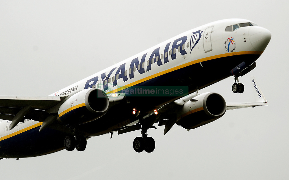 File photo dated 02/07/12 of a Ryanair plane, as the low cost carrier pledged to continue cutting fares as it posted a 6\% rise in annual profits despite intense competition and the Brexit vote.