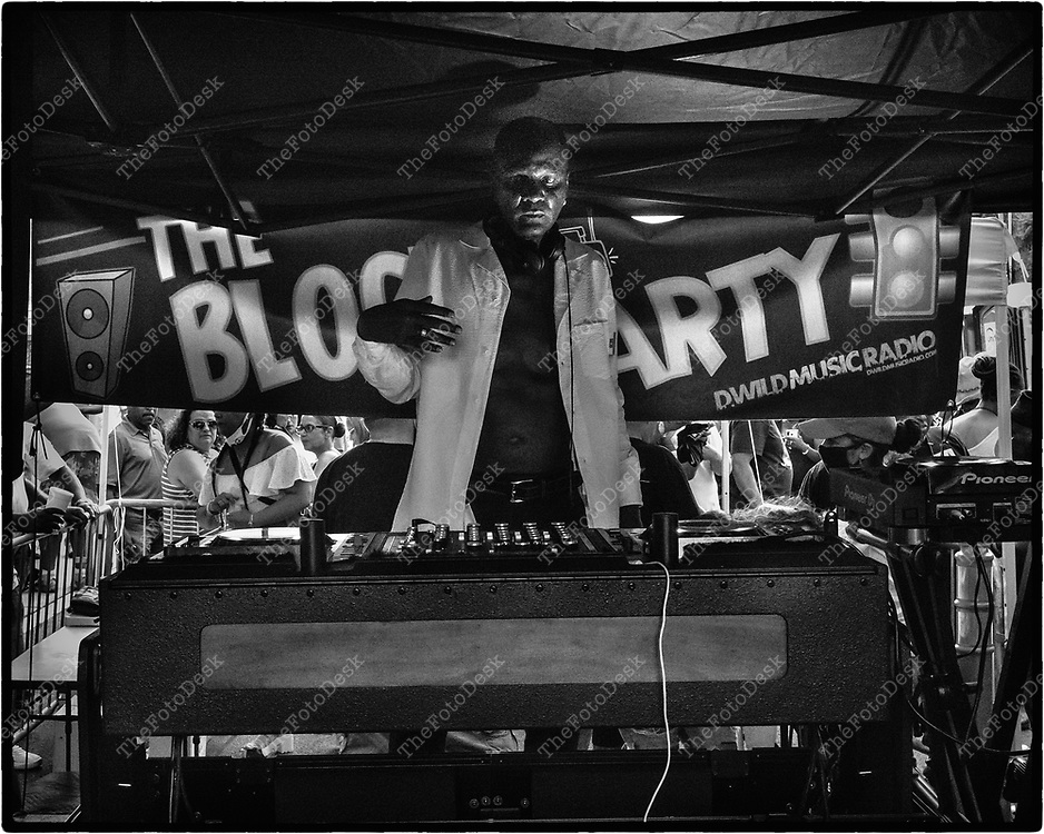 NEWARK, NEW JERSEY: DJ Kenny Carpenter, on the one's and two's during his set at the weekly Block Party on Edison Plaice in Newark, NJ on Friday, July 30, 2021 (Brian B Price/TheFotodesk).