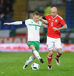 Steven Davis of Northern Ireland challenges for the ball with David Cotterill of Wales - Mandatory by-line: Dougie Allward/JMP - Mobile: 07966 386802 - 24/03/2016 - FOOTBALL - Cardiff City Stadium - Cardiff, Wales - Wales v Northern Ireland - Vauxhall International Friendly