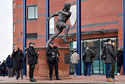 Armed police look-on as fans arrive at the Hawthorns