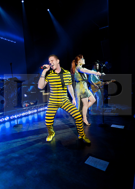 """© Licensed to London News Pictures. 16/05/2012. London, UK. Scissor Sisters perform live at O2 Shepherd's Bush Empire.  They are to perform as part of London's Olympic Festival on the BT River of Music America's Stage during the weekend of the 21-22 July 2012.  The group's fourth album """"Magic Hour"""" is due to be released on 28th May.  Scissor Sisters are an American band, formed in 2001, the band """"spawned by the scuzzy, gay nightlife scene of New York"""".  Its members comprise Jake Shears and Ana Matronic as vocalists, Babydaddy as multi-instrumentalist, Del Marquis as lead guitar/bassist, and Randy Real as drummer.  In this picture - Jake Shears, Ana Matronic.  Photo credit : Richard Isaac/LNP"""