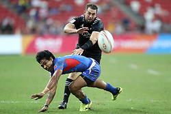 April 29, 2018 - Singapore - Kurt Baker of New Zealand (right) competes for the ball with Murphy Paulo of Samoa during the Cup fifth place play off match between New Zealand and Samoa at the Rugby Sevens tournament at the National Stadium. Singapore. (Credit Image: © Paul Miller via ZUMA Wire)