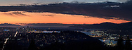 View of the City of Vancouver, North Vancouver, and beyond from Burnaby Mountain after sunset. Ther mountain in the top left of the horizon is Mount Arrowsmith on Vancouver Island. On the left is downtown Vancouver and North and West Vancouver is on the right.  Houses and hills (Captiol Hill) in the foreground are in north Burnaby.  Photographed from Burnaby Mountain Conservation Area in Burnaby, British Columbia, Canada.
