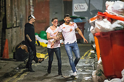 © Licensed to London News Pictures . 01/11/2015 . Manchester , UK . A scuffle breaks out on a side street . Halloween revellers , wearing make up and costumes , out and about in Manchester City Centre . Photo credit : Joel Goodman/LNP