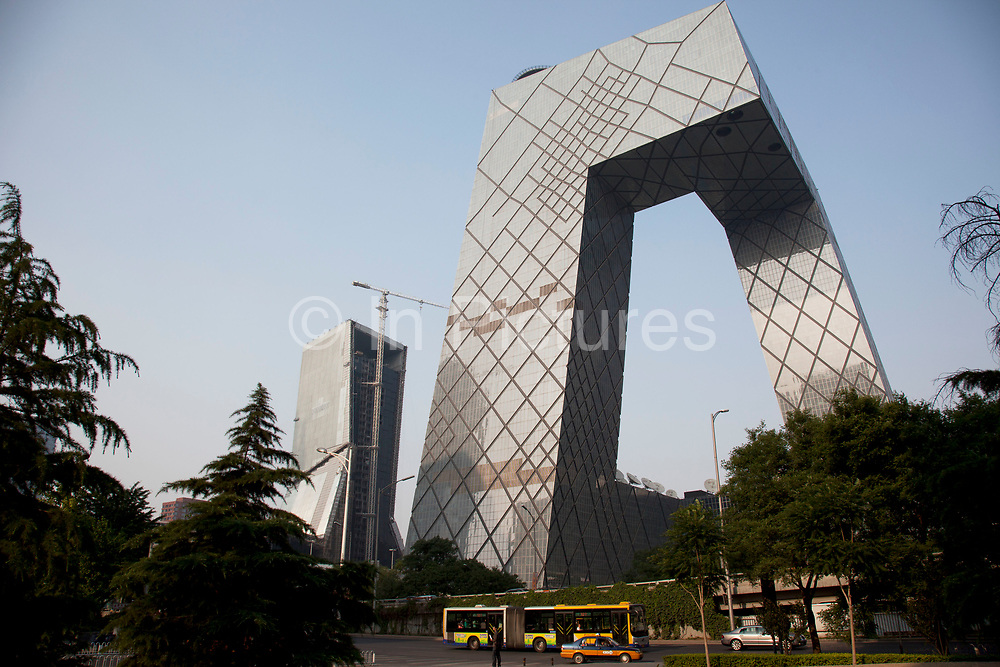 The CCTV Headquarters is a 234m 44-storey skyscraper in the Beijing Central Business District or CBD. Affectionately known by the Chinese locals as The Underpants Building due to it's unique design. The tower serves as headquarters for China Central Television. Construction began in 2004 and the building's facade was completed in 2008. After the construction having been delayed as result of a fire which in February 2009 engulfed the adjacent Television Cultural Center, the Headquarters has been finally completed in May 2012. Rem Koolhaas and Ole Scheeren of OMA were the architects in charge for the building, while Arup provided the complex engineering design.