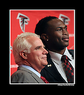 Atlanta Falcon head coach Mike Smith  takes a photo with his top pick in the NFL Draft, Julio Jones, at the Atlanta Falcons facility on Friday, April 29, 2011.