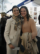 Nicola( peach) Tranah and Laura Tranah, The Affordable Art Fair private view ( in aid of Barnados) Battersea. 19 March 2003. © Copyright Photograph by Dafydd Jones 66 Stockwell Park Rd. London SW9 0DA Tel 020 7733 0108 www.dafjones.com