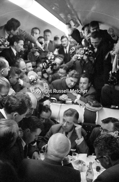 1960. Impromptu  press conference in dining car of french train on the way to Verdun.<br /> I was the only photographer allowed<br /> behind Khrushchev during the press conference.<br /> AP put out a picture of this conference where I can be seen standing behind Kruschev rewinding the film in my camera.<br /> <br /> 1960. Conférence de presse impromptu dans le wagon du train français en route  pour Verdun .<br /> Je suis le seul photographe autorisé<br /> derrière Khrouchtchev lors de la conférence de presse .<br /> Associated Press a pris une photo de cette conférence où je peux être vu debout derrière Kruschev  en train de rembobiner le film dans mon appareil photo .