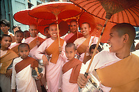 Women monks  on their way to receive offerings of food, in Rangoon (Yangon), Myanmar (Burma).Photo by Owen Franken.