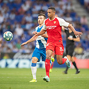 BARCELONA, SPAIN - August 18:  Fernando #25 of Sevilla and Victor Campuzano #31 of Espanyol challenge for the ball during the Espanyol V  Sevilla FC, La Liga regular season match at RCDE Stadium on August 18th 2019 in Barcelona, Spain. (Photo by Tim Clayton/Corbis via Getty Images)