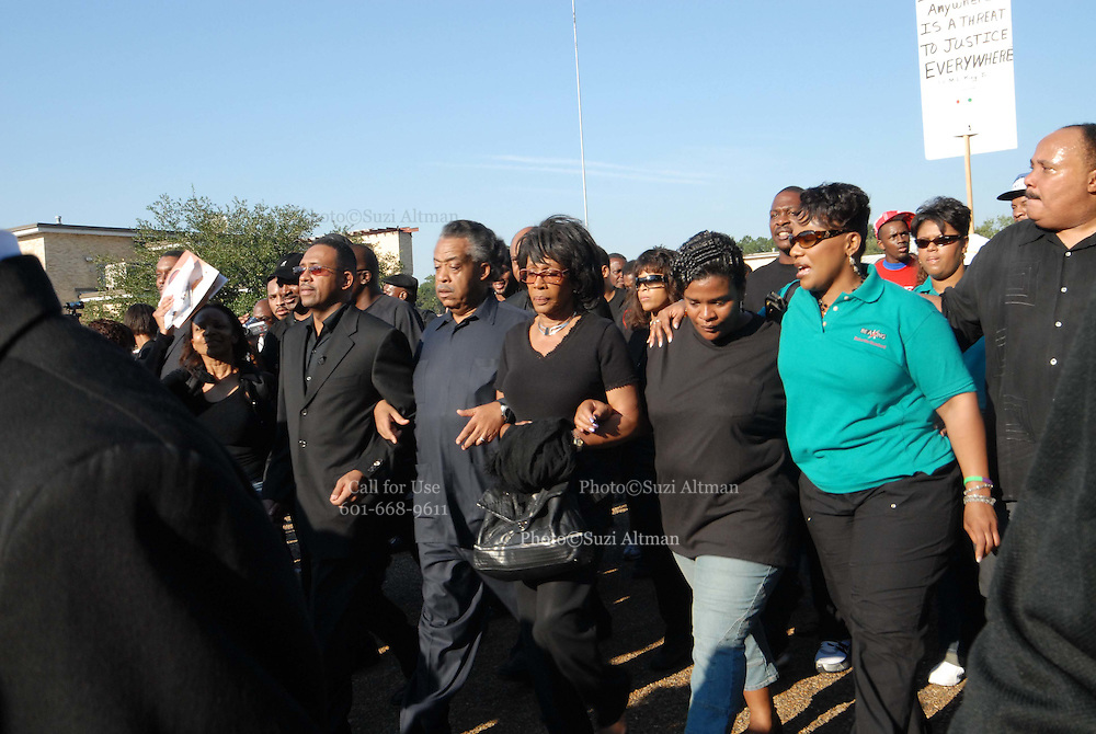 Rev. Al Sharpton marches in front Jena high School Thursday Sept. 20, 207 in a ralley for justice.He is flanked by Michael Baisden,left, radio personality and on the right by a congresswoman and the Michael Bells Mother and far right Martin Luther king 's daughter in real shirt.(Photo/© Suzi Altman)
