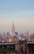 The view of the Empire State Building from the Brooklyn Bridge at sunset, New York City, New York