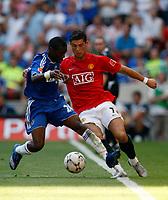 Photo: Richard Lane/Sportsbeat Images.<br />Manchester United v Chelsea. FA Community Shield. 05/08/2007. <br />Manchester United's Christiano Ronaldo breaks past Chelsea's Shaun Wright-Phillips.