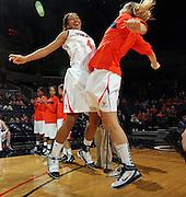 Nov. 14, 2010; Charlottesville, VA, USA;  Virginia center Simone Egwu (4) chest bumps Virginia forward Jayna Hartig (32) before the start of the game against Mt. St. Mary's at the John Paul Jones Arena.  Mandatory Credit: Andrew Shurtleff-